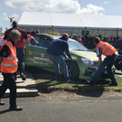 Race director Mervyn White's car is pushed off the North West 200 track