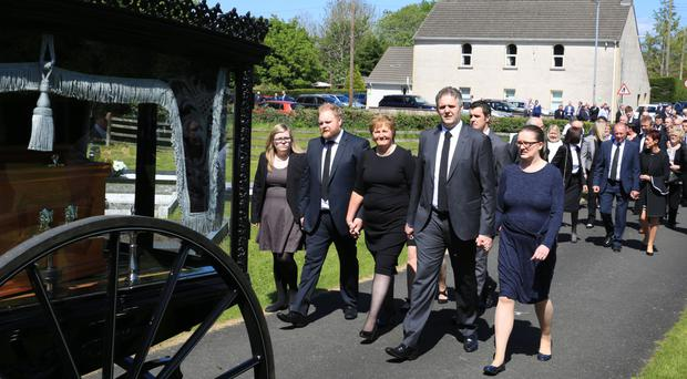 The funeral cortege of Ivan Bradshaw is followed by his wife Evelyn and sons Stuart, Jonathan and Peter