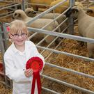 Annabel Manson (6) from Kells with a first prize for her Hampshire Down ewes