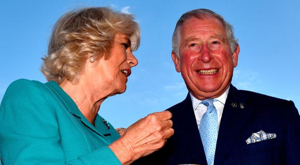 The Prince of Wales and the Duchess of Cornwall during their visit to Dromore yesterday