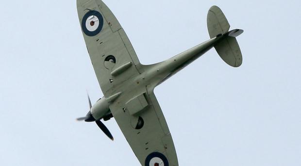 A spitfire on display at an air show