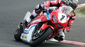 John McGuinness rides his bike seconds before the accident