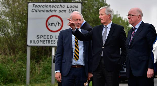 Michel Barnier (centre) visiting the border region yesterday. (Photo by Charles McQuillan/Getty Images)