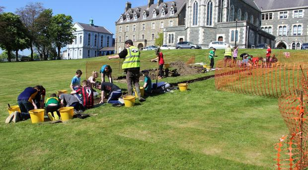 Pupils from Lumen Christi carry out excavations in the school grounds