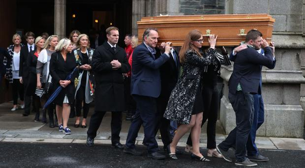 The coffin of Brendan Duddy leaves St Eugene's Cathedral in Londonderry after his funeral service