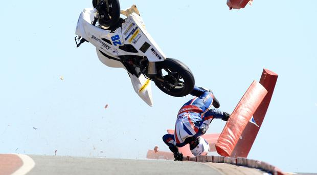 Rider Chris Dixon escapes serious injury during a crash at the North West 200 in Portrush