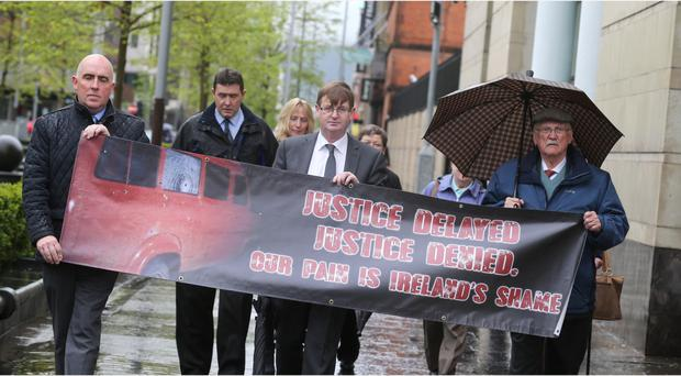 Willie Frazer (centre) and relatives of some of the Kingsmill victims arrive at Laganside Court