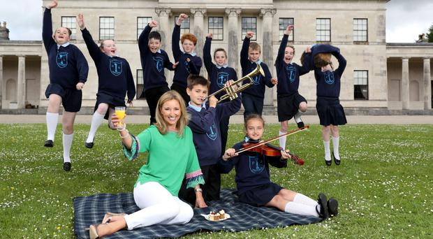 Claire McCollum and Fintona's St Lawrence's PS children at Castle Coole