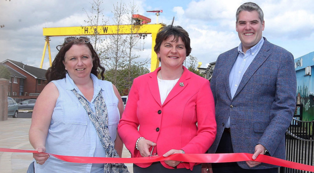 DUP leader Arlene Foster opens a new walkway in the Pitt Park area of east Belfast with Roz Small of Ballymac Friendship Trust and DUP candidate Gavin Robinson