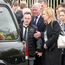 Conor Leonard, son of Concepta, is comforted by his grandfather Dinny Leonard