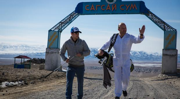 Adam Rolston (left) and Ron Rutland go through their preparations in Mongolia for what will be the longest round of golf ever attempted