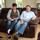 Robin Swann relaxes at home with his wife Jenny