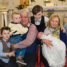 Pat and Elizabeth Canavan and their grandchildren