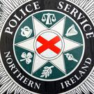Two police officers were injured when their patrol car was struck by the van in Warrenpoint