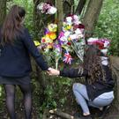Friends of the dead girl lay flowers in her memory at Corcrain Community Woodland in Portadown