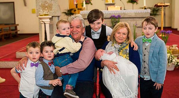 Elizabeth Canavan, who has returned home after 11 weeks in hospital with her husband Pat and their grandchildren. Grandmother Elizabeth, who suffers from motor neurone disease, had been left languishing in hospital because health chiefs were unable to provide a care package for her at home
