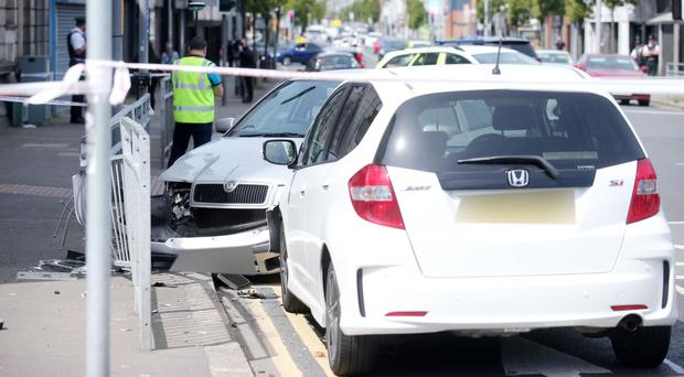 The scene at the Holywood Arches in east Belfast where a two vehicle collision has cause the Newtownards Road to close