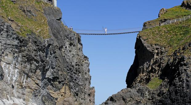 The Carrick-a-Rede rope bridge on the Causeway coast is one of the region's top tourist attractions