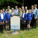 Relatives and local school pupils attend the unveiling of the restored headstone and plaque to Oswald Short at Lynchmere, West Sussex