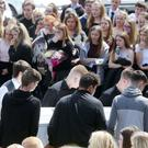 Young mourners look on as the coffin of Caitlin White arrives at Drumalane Church in Newry yesterday