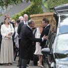 The coffin of Lady Jane Gillespie is carried into St John's Church, Caledon, yesterday