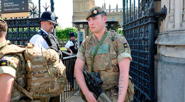 Irish Guards leave the Palace of Westminster yesterday