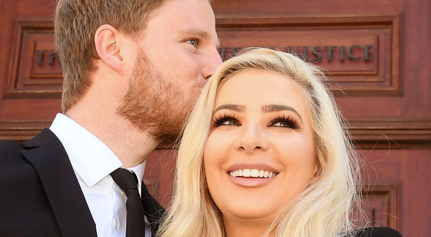 Model Laura Lacole arrives at Belfast High Court with fiance Eunan O'Kane yesterday