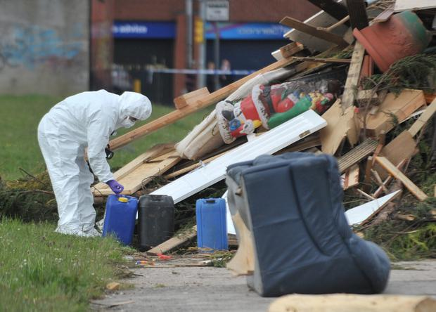 A forensic officer checks out chemicals dumped at Glenwood Street, north Belfast