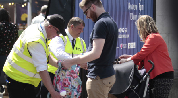 Security staff checking people's bags as they enter the grounds of Belfast City Hall yesterday