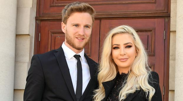 Model Laura Lacole and footballer Eunan O'Kane at Belfast's High Court, last Friday