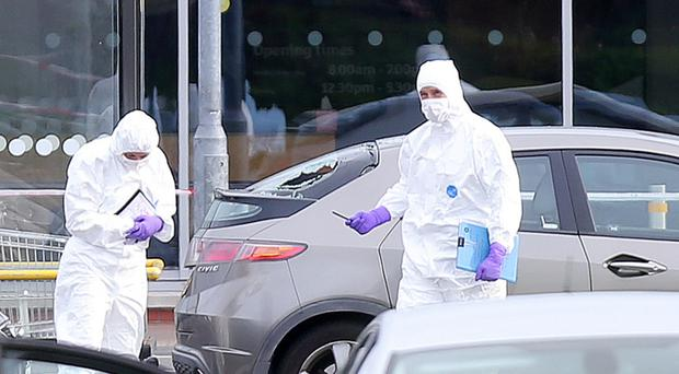 Forensic officers at the scene of the shooting at Sainbury's supermarket in Bangor
