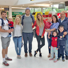 From left: Jared Payne with son Jake and partner Christina; Iain Henderson with fiancee Suzanne Flanagan, and Rory Best, with wife Jodie holding baby Richie, and children Ben and Pen