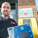 Richard Campbell of Spar shop on the Rossdowney Road in Londonderry, with the defibrillator donated to the store after the original one was stolen