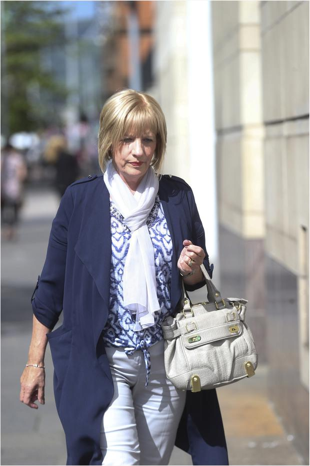Karen Armstrong whose brother was killed, arrives at court in Belfast yesterday