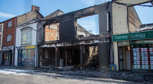 Some of the six businesses that were destroyed by the fire in Ballymena's Broughshane Street on Tuesday
