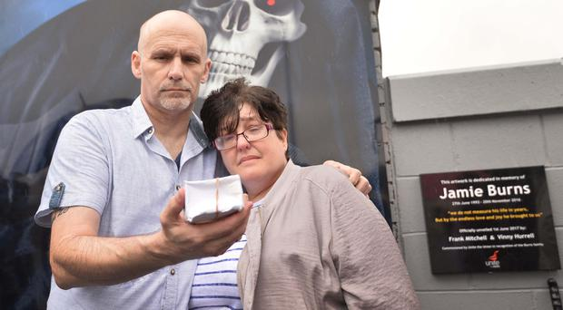 William and Lesley Burns with the ashes of their son Jamie at the unveiling of the billboard