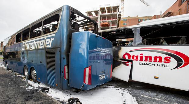 The two tourist buses which were damaged in a fire outside a Sandy Row hotel in Belfast