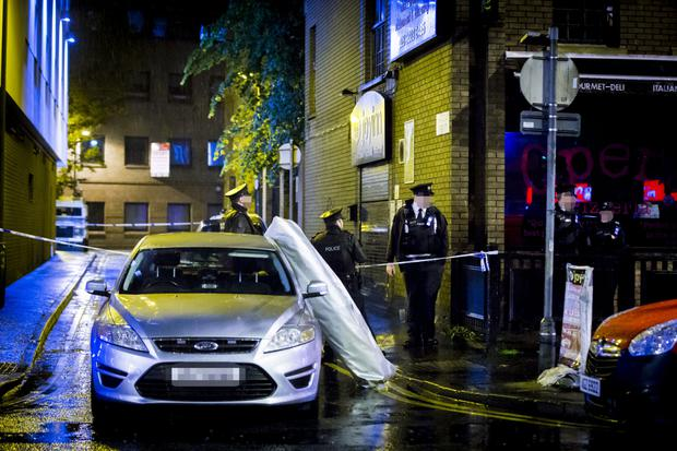 Police officers at the scene of a fatal stabbing at the Little Victoria Street car park on Bruce Street