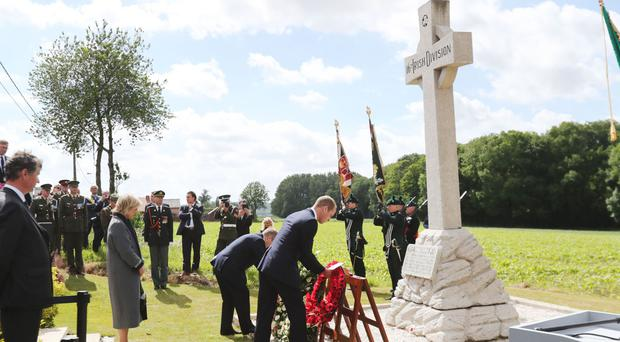 The Duke of Cambridge, right, and Taoiseach Enda Kenny lay wreaths at the 16th Irish Division Memorial Cross during a ceremony at Wytschaete Military Cemetery