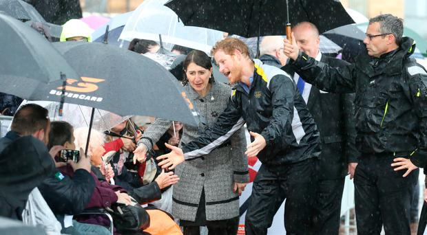 Prince Harry meets Daphne Dunne on a walkabout on Circular Quay in Sydney to mark the official launch of the Invictus Games