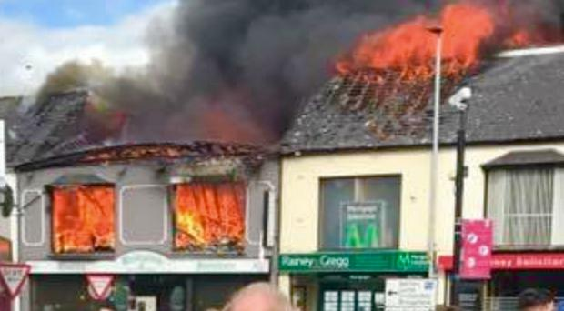 Buildings ablaze during the catastrophic fire in Ballymena last week