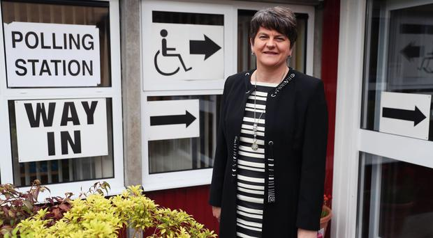 Arlene Foster, leader of the Democratic Unionist Party, arrives to cast her vote in the General Election