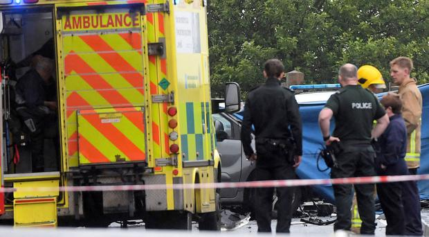 Emergency services at the scene after a crash on Doagh Road in Newtownabbey yesterday