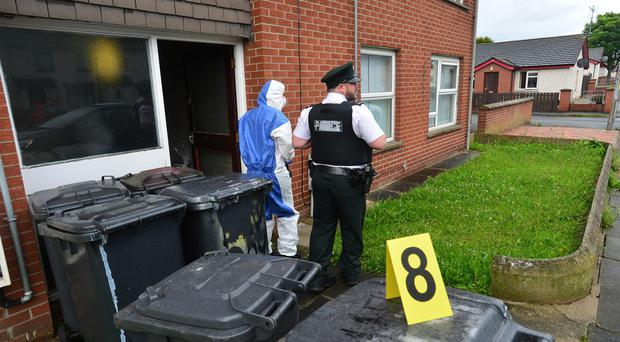 Police and forensics officers at the scene in Newtownards yesterday