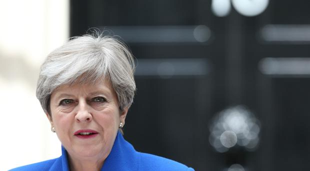 May vows to stay on as British prime minister