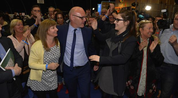Sinn Fein's Paul Maskey celebrates his win at the Titanic Centre