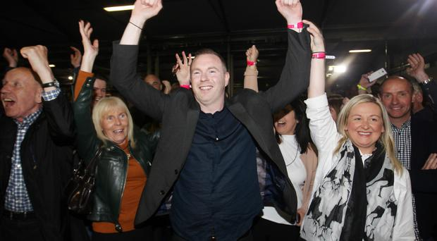Sinn Fein's Chris Hazzard celebrates winning South Down seat from SDLP's Margaret Ritchie
