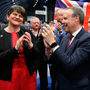 DUP leader Arlene Foster and deputy leader Nigel Dodds celebrate on early hours of Friday