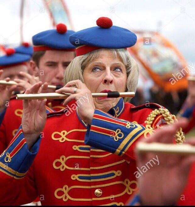 Mock-ups of Theresa May in a band