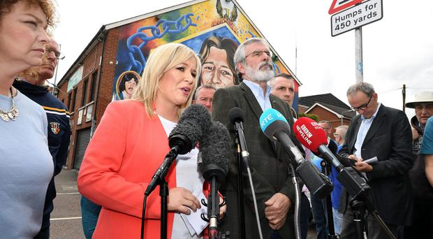 Sinn Fein's Michelle O'Neill and Gerry Adams talk to the media yesterday
